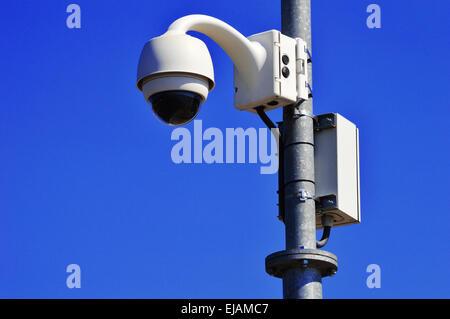 Hi-tech dome type camera over  blue sky - Stock Photo