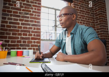 Designer sketching on graphics tablet - Stock Photo