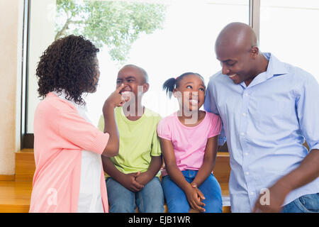 Happy family spending time together - Stock Photo