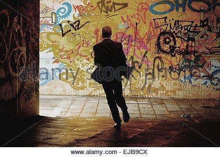 man running through an underpass - Stock Photo