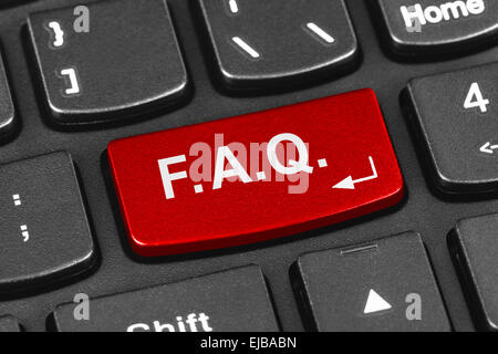 Computer notebook keyboard with FAQ key - Stock Photo
