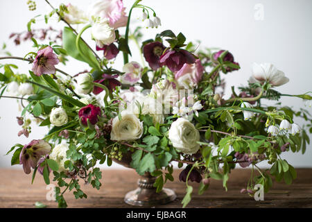 Spring bouquet of parrot tulips, ranunculus, anemones and Lucojum - Stock Photo