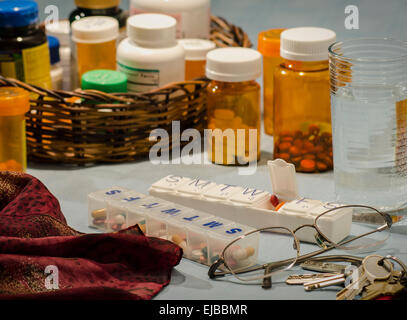 multi-day pill organizers with bottled prescriptions - Stock Photo