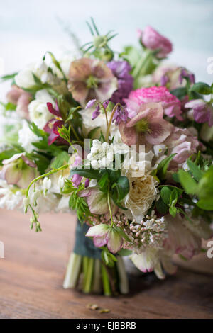Abundant floral bouquet of spring blooming flowers including ranunculus hellebore parrot tulip tulipa and white - Stock Photo