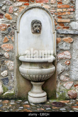 Old Well on Stone Wall - Stock Photo