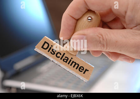 disclaimer marked on rubber stamp - Stock Photo