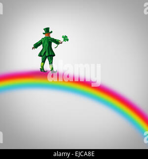 Leprechaun Fortune Rainbow as a small character in a green traditional saint patricks day costume holding a four - Stock Photo