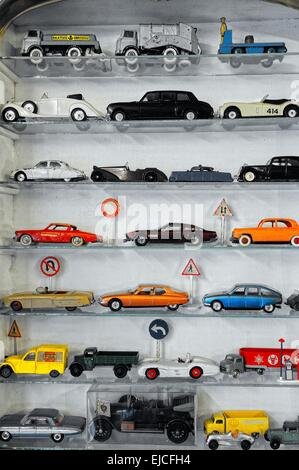 Toy cars in the showcase - Stock Photo