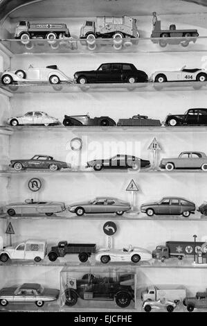 Toy cars black and white in the showcase - Stock Photo