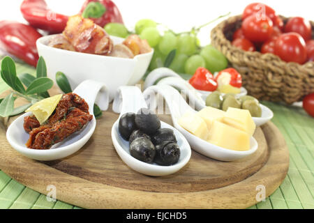 Tapas with prunes, figs and apricots - Stock Photo