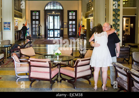 A man and woman hug in the King David Hotel elegant and luxurious lobby. The hotel has hosted many important dignitaries - Stock Photo