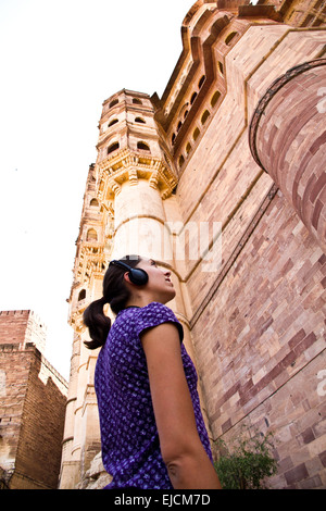 Young woman with Audioguide in Jodhpur - Stock Photo