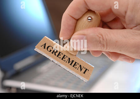 rubber stamp marked with agreement - Stock Photo