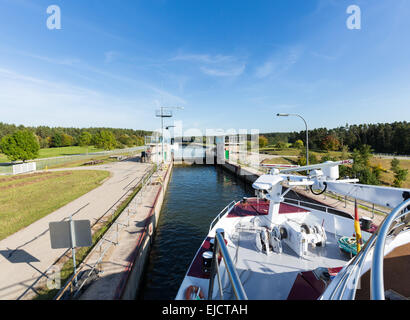 Cruise boat leaves lock on canal - Stock Photo