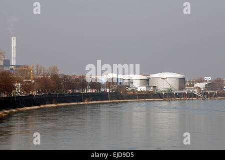 Industry beside the river Rhine, Niehl, Cologne, Germany. - Stock Photo