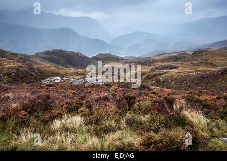 Dramatic rainy weather in Snowdonia. Rain falling on hills and mountains near Beddgelert. - Stock Photo