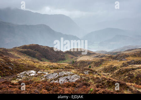Dramatic rainy weather in Snowdonia. Rain falling on hills and mountains near Beddgelert. - Stock Photo