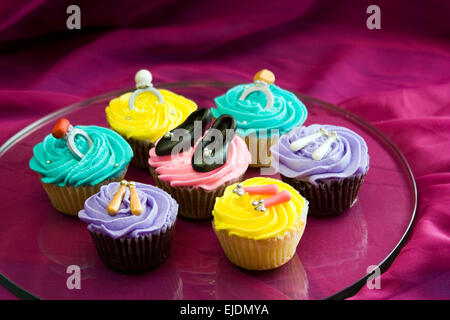 Cupcakes decorated with handmade candy shoes and jewelry - Stock Photo
