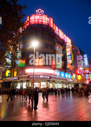 Neon signs on Nanjing Road busy shopping street, Shangai, China - Stock Photo