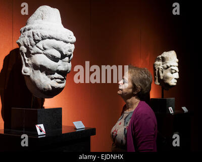 Woman admiring ancient chinese art at the Shanghai Museum in Shanghai, China - Stock Photo