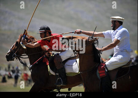 Rival polo teams from Chitral and Gilgit compete during the worlds highest polo match on the Shandur Pass, Chitral, - Stock Photo