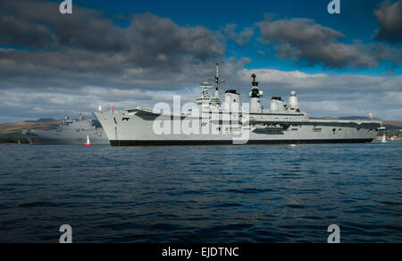 The Royal Navy Invincible class HMS Ark Royal with the French helicopter carrier FS Tonnerre at anchor in the Firth - Stock Photo