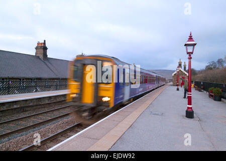 A Northern Rail train leaving Garsdale station on the Settle Carlisle line, Yorkshire Dales, UK - Stock Photo