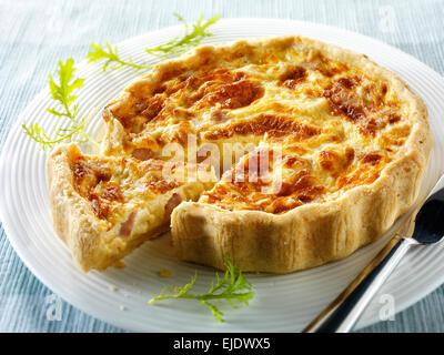 Slices of quiche Loraine whole - Stock Photo