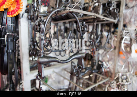Close-up of a pile of brand new horse bits, Spain - Stock Photo