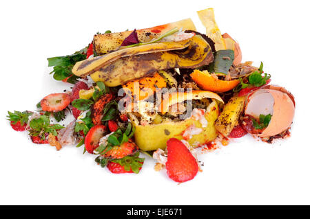 a pile of food waste, such as eggshells and fruit and vegetable peels, on a white background - Stock Photo