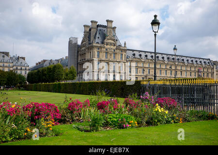 The colorful gardens in the large park outside the Louvre art museum in Paris, France pop with color in the early - Stock Photo