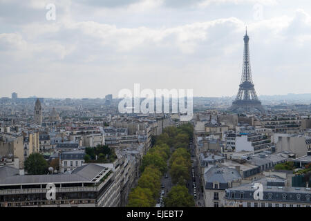 In a view from atop the Arc du Triomphe, the famous Eiffel Tower rises above Paris, France on a lovely fall afternoon. - Stock Photo