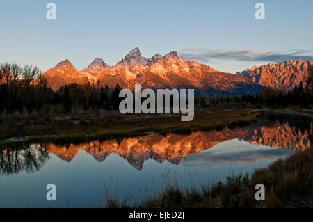 Teton Mountains in an autumn sunrise reflected in pond near Schwabachers Landing in Grand Teton National Park Wyoming - Stock Photo