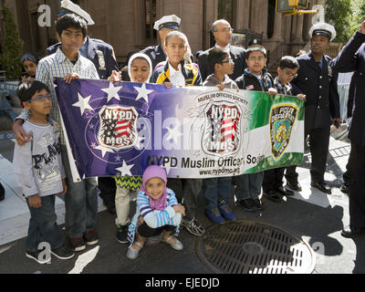 Muslim NYPD police officers and their families at the Muslim American Day Parade n New York City, 2014.. - Stock Photo