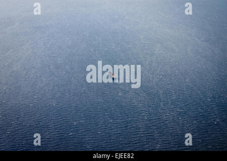 Aerial side view of oil tanker ship on open sea - Stock Photo