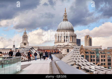 St Paul's Cathedral from the Millennium Bridge, London, England, under a dramatic sky. - Stock Photo