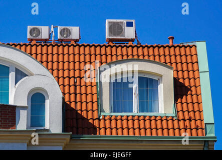 Air conditioners on the top of a building - Stock Photo
