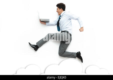 Business men holding laptop running on a white background - Stock Photo