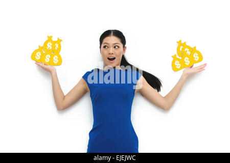 Young woman hand holds the purse strings - Stock Photo