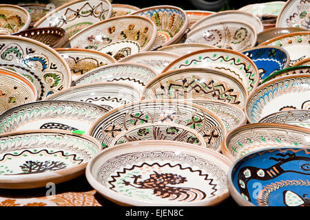 Colourful hand-painted plates from Romania exposed to market - Stock Photo : ceramic painted plates - pezcame.com