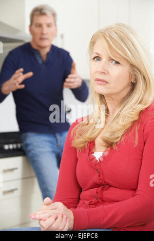 Mature Couple Having Argument At Home - Stock Photo