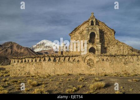 Nevado Sajama, highest peak in Bolivia behing an old church in Sajama national park - Stock Photo