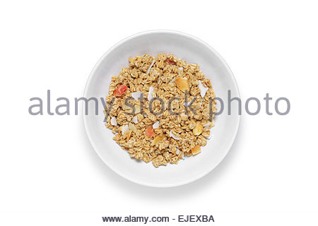 Granola cereal with dried fruits in white bowl, shot from above isolated on white background with clipping path - Stock Photo
