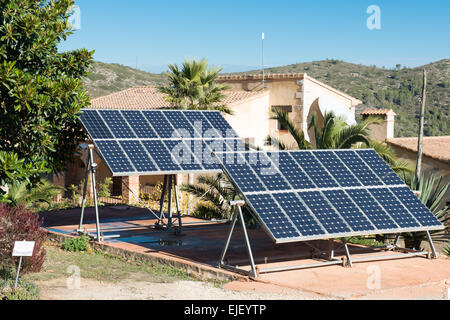 Two large solar panels in a garden in Spain - Stock Photo