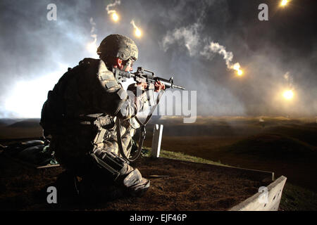 Sgt. Larry J. Isbell, representing the National Guard, watches his firing lane for targets during the M-4 Range - Stock Photo