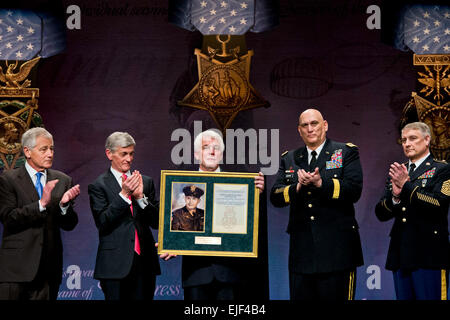 Defense Secretary Chuck Hagel, far left, applauds during a ceremony to induct Medal of Honor recipient Army Chaplain Capt. Emil Kapaun into the Hall of Heroes at the Pentagon, April 12, 2013. Ray Kapaun, the chaplain's nephew, represented his uncle, who served in the Korean War, during the ceremony. Army Secretary John M. McHugh, second from left, Army Chief of Staff Gen. Ray Odierno, second from right, and Sgt. Maj. of the Army Raymond F. Chandler III, far right, participated in the ceremony. DOD photo by Erin A. Kirk-Cuomo