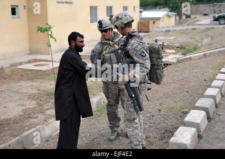 U.S. Army Sgt. Edgar Fierro, of Clarksville, Tenn., a forward observer, and Sgt. Michael S. Lachapelle, of Miami, - Stock Photo