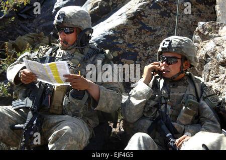 U.S. Army Capt. Christopher Demure, commander of 2nd Battalion, 508th Parachute Infantry Regiment, checks his terrain - Stock Photo