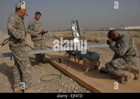 U.S. Army Staff Sgt. Alton Jefferson and Sgts. Ronald Williams and Jeremy Squires, all from Bravo Company, 173rd Special Troops Battalion, conduct final checks on a Shadow Unmanned Aerial Vehicle UAV on Forward Operating Base Fenty in Jalalabad, Afghanistan, March 17, 2008, prior to its launch. A UAV is used to track enemy activity.  Staff Sgt. Tyffani L. Davis
