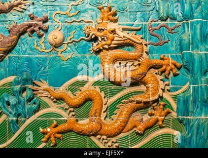 A traditional Chinese decoration on the Nine Dragon Wall in Beijing, China - Stock Photo